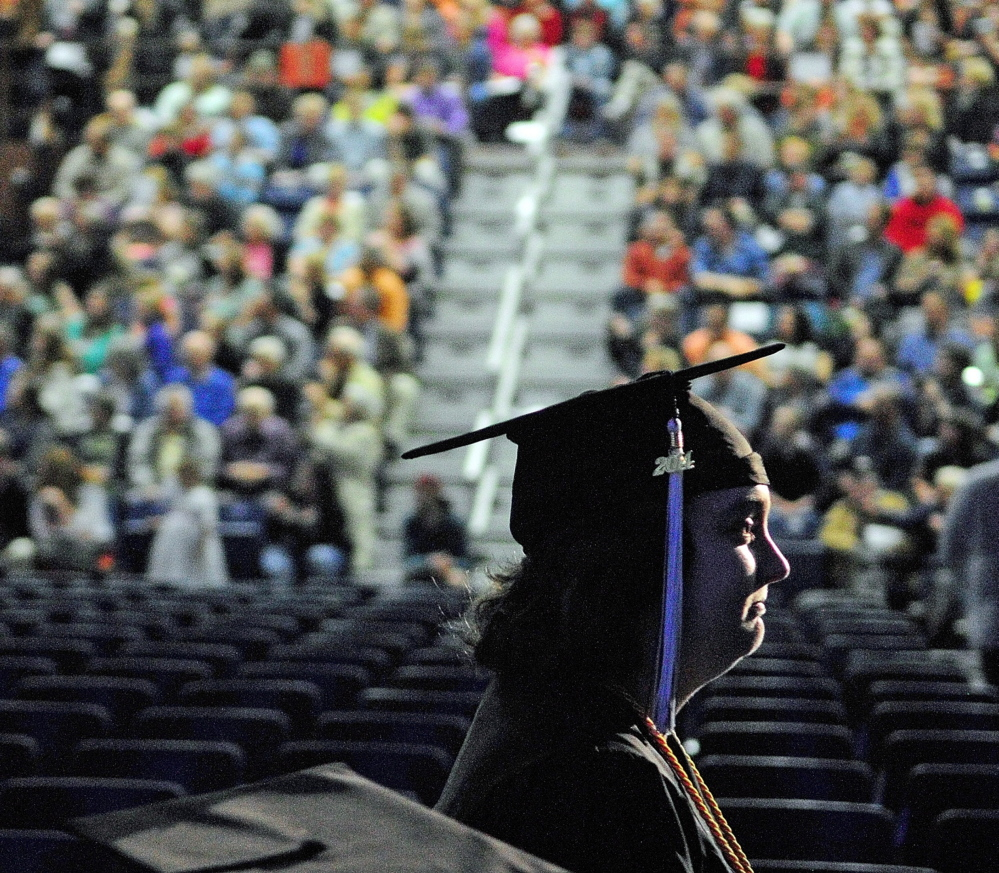 AUGUSTA, ME - MAY 10: A graduate marches in front of a large crowd during graduation for University of Maine at Augusta on Saturday May 10, 2014 at the Augusta Civic Center. (Photo by Joe Phelan/Staff Photographer)