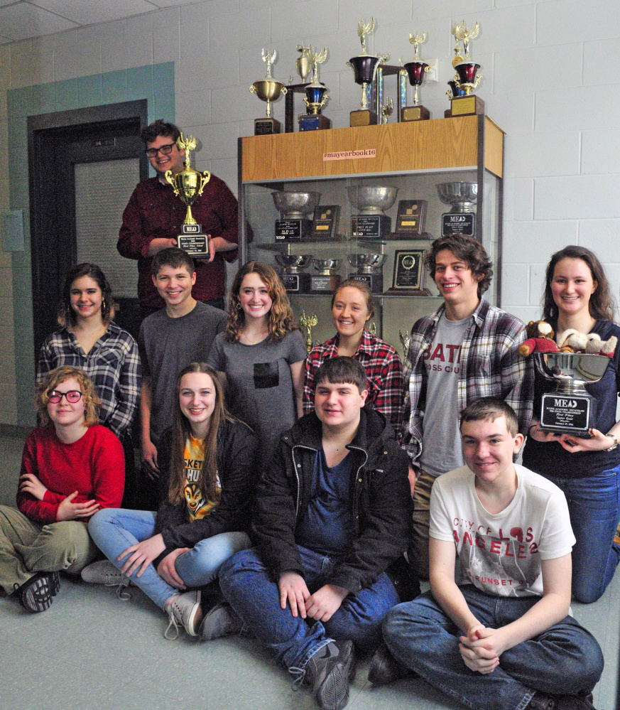 State champion Academic Decathlon team from Monmouth Academy shows off the school's fifth state championship trophy in the event on March 2. The team returned Sunday from Alaska where they placed seventh in the small school division. Members of the team are from left, front row, Liliana Stewart, Maddie Amero, Chris Dumont, Gerard Boulet; second row, Emmeline Willey, Dylan Goff, Sammy Grandahl, Madi Bumann, Luke Thombs, Becky Bryant; back row Corey Tartarka.