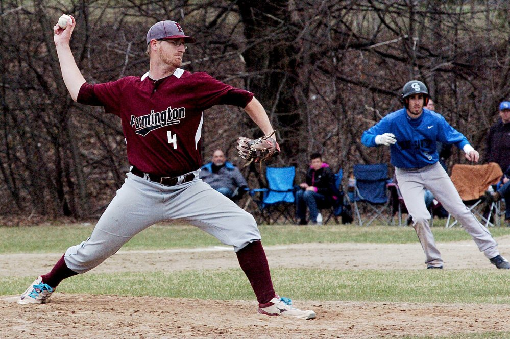 University of Maine at Farmington pitcher Kyle Peterson throws to a Colby-Sawyer batter during the first game of a doubleheader Sunday in Farmington.