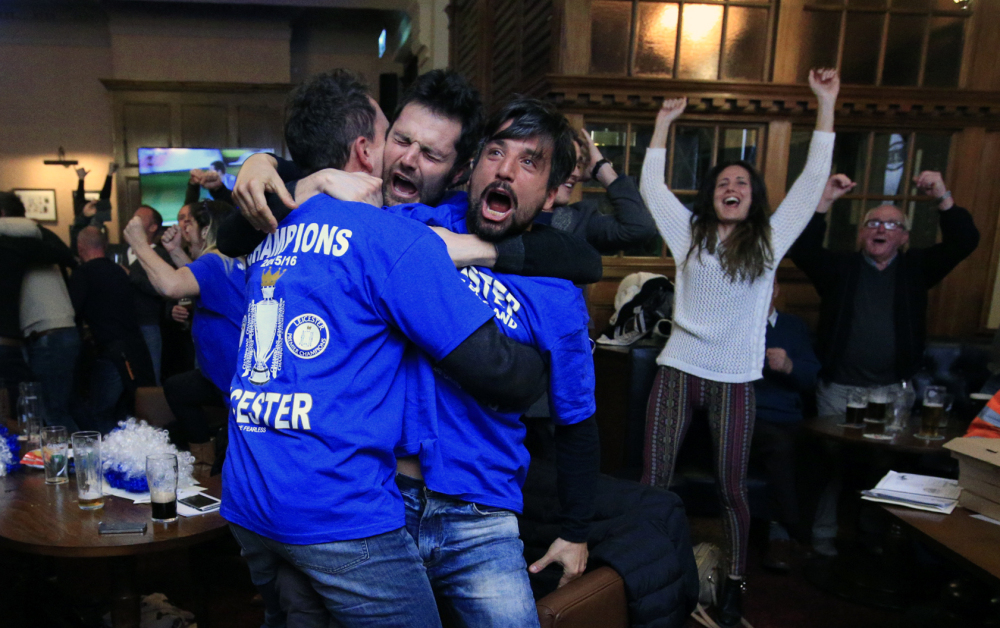 Leicester City fans react in Hogarths public house in Leicester, central England, after Chelsea's Eden Hazard scored the tying goal against Tottenham Hotspur in an English Premier League soccer match Monday. The match ended 2-2 resulting in Leicester City winning the Premier League, one of the biggest upsets in the history of sports.