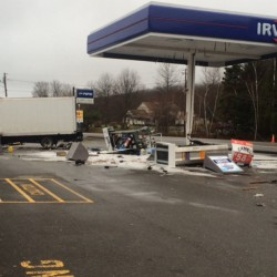 A box truck veered off Route 3 on Tuesday morning in Liberty, crashing into utility poles and fuel pumps at a Circle K store and Irving station.
