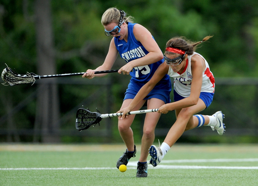 Lewiston's Allison Frechette, left, battles for the ball with Messalonskee's India Languet during an Eastern A semifinal last season at Thomas College in Waterville. Languet has elevated her gamr in the midfield with Nathalie St. Pierre out with an inkle injury.