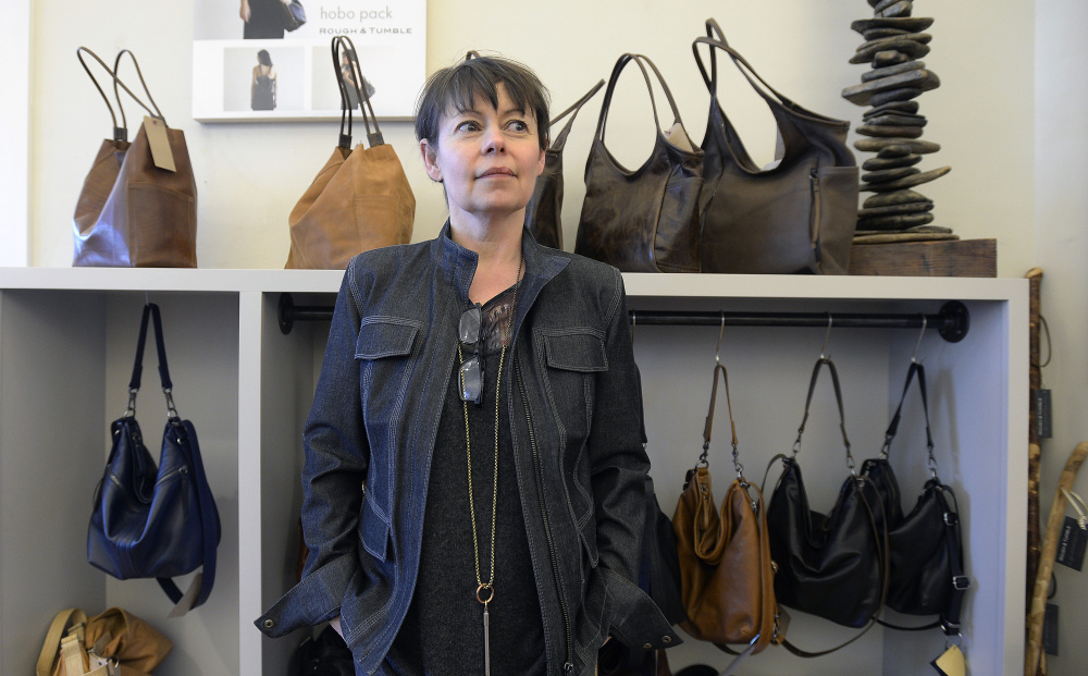 Natasha Durham once owned three restaurants in Portland. Now she is a handbag designer.