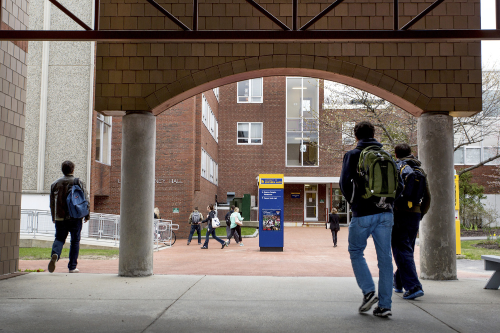 Students change classes Tuesday near Luther Bonney Hall at the University of Southern Maine in Portland. At USM, which also has campuses in Gorham and Lewiston, enrollment for fall 2016 has so far risen by 10 percent to 563 first-year students.