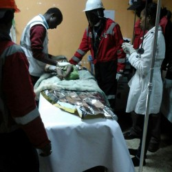 Kenya Red Cross paramedics in Nairobi on Tuesday attend to a baby girl rescued from the rubble of a six-story building that collapsed after days of heavy rain.