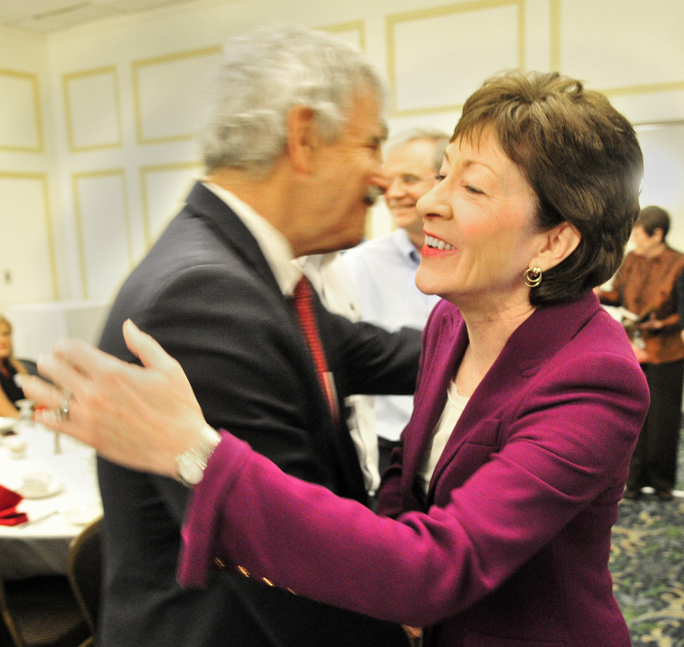 Sen. Roger Katz, R-Augusta, and U.S. Sen. Susan Collins, R-Maine, hug before a Kennebec Valley Chamber of Commerce event on Wednesday at the Senator Inn & Spa in Augusta.
