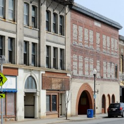 The Haines Building, left, and former Atkins Printing buildings on Main Street in downtown Waterville are two of several buildings slated for redevelopment. With all the planned development in downtown Waterville, the City Council on Tuesday agreed to ask the state to extend the downtown tax increment financing agreement, which would expire in nine years, to be extended another 10 years.