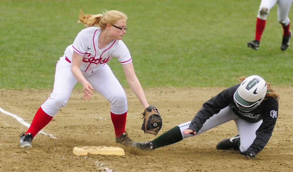 Cony shortstop Autumn Sudsbury tries to tag Oxford Hills baserunner Cora Hooker at third base during a Kennebec Valley Athletic Conference Class A game Wednesday at Cony Family Field in Augusta.