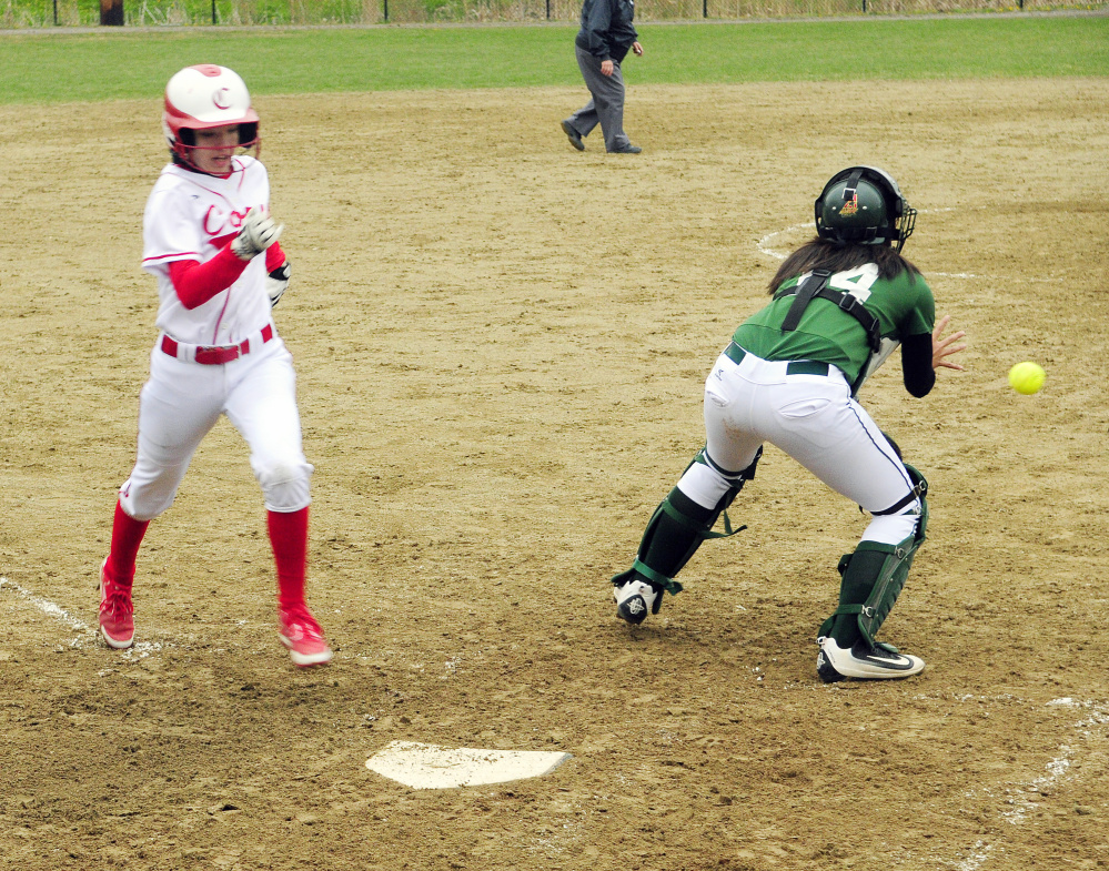 Carrie Meehan, left, beats the throw to Oxford Hills catcher Anna Piirainen to score on a double by teammate Haley Wood during a Kennebec Valley Athletic Conference Class A game Wednesday at Cony Family Field in Augusta.