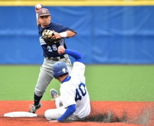 Colby captain Daniel Csaplar slides into second base as University of Maine second baseman Caleb Kerbs tries to turn a double play in the first inning of a non-conference game Wednesday afternoon in Waterville.