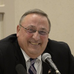 "Gov. Paul LePage laughs during Wednesday's town hall forum in Lewiston. Speaking of a possible Trump administration, he told the audience at one point, ""So what about if I become the ambassador to Canada in the summer and Jamaica in the winter?"""