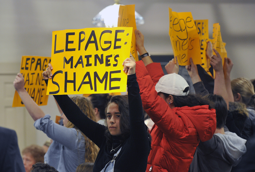 LEWISTON, ME - MAY 4: A group of college age students protest Gov. Paul LePage as he holds a town hall meeting in Lewiston Wednesday, May 4, 2016. The group was escorted from the event. (Photo by Shawn Patrick Ouellette/Staff Photographer)