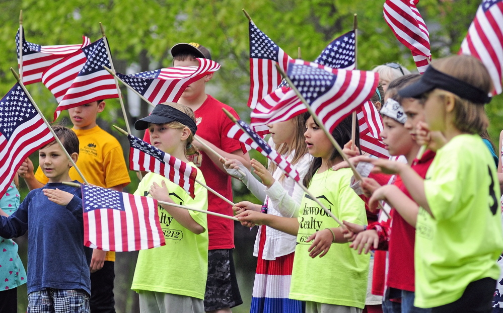 "File photo   Wayne Elementary School students sing, ""You're A Grand Old Flag"" during Memorial Day events last year. They'd recently learned the song from Bonnie Wilder, of the Daughters of the American Revolution Koussinoc Chapter, who taught the patriotic song during a school field trip to the Old North Wayne School."