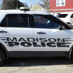 Two Madison Police Department cruisers stand parked outside the department in March 2015. The department merged with the Somerset County Sheriff's Office in July, and two former Madison officers have filed a complaint with the Maine Human Rights Commission, alleging age discrimination.