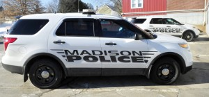 Two Madison Police department cruisers are parked outside the department in March 2015. The department merged with the Somerset County Sheriff's Office in July, and two former officers are suing for age discrimination.