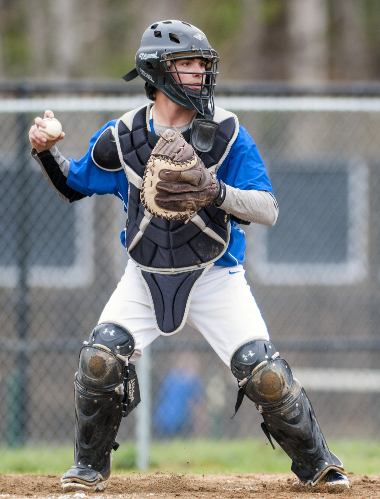 Erskine Academy catcher Nick Turcotte pops up ready to throw in case the runner at first tries to steal during game against Maranacook on Tuesday in Readfield.
