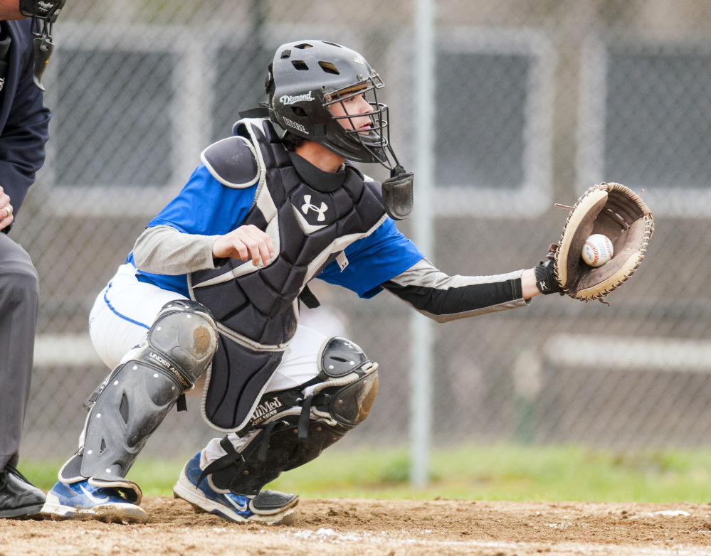 Erskine Academy catcher Nick Turcotte catches a pitch during game against Maranacook on Tuesday in Readfield.