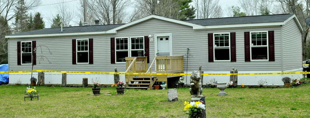Police tape surrounds a mobile home at 3 Alley Lane in Troy after fire did serious damage to the interior Wednesday night.