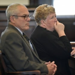 Julie Smith sits next to her attorney, Woody Hanstein, as she listens to Superior Court Justice Robert Mullen during court proceedings in Somerset County Superior Court in Skowhegan on Friday. Smith, a former clerk in the Somerset County District Attorney's Office, pleaded guilty to embezzlement.