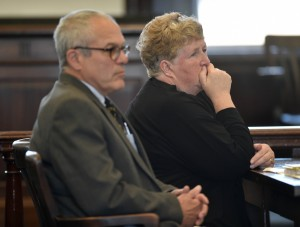 Julie Smith sits next to her attorney, Woody Hanstein, as she listens to Superior Court Justice Robert Mullen during court proceedings Friday in Somerset County Superior Court in Skowhegan. Smith, a former clerk in the Somerset County District Attorney's Office, pleaded guilty to embezzlement.