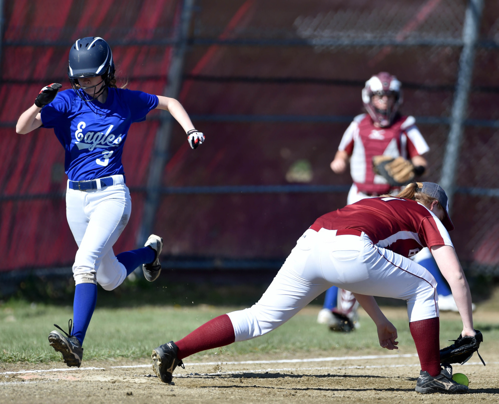 Messalonskee's Mackenzie Charest (3) beats out the throw to Bangor's Jenna Bishop (11) at first base Friday in Oakland.