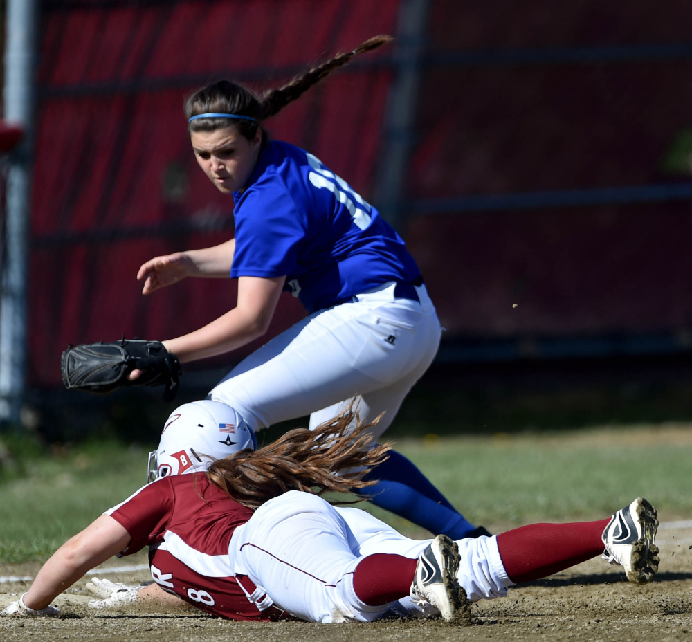 Bangor's Megan Conner (8) narrowly makes it back to first base safely as Messalonske's Katie Guarino tries to apply the tag Friday in Oakland.
