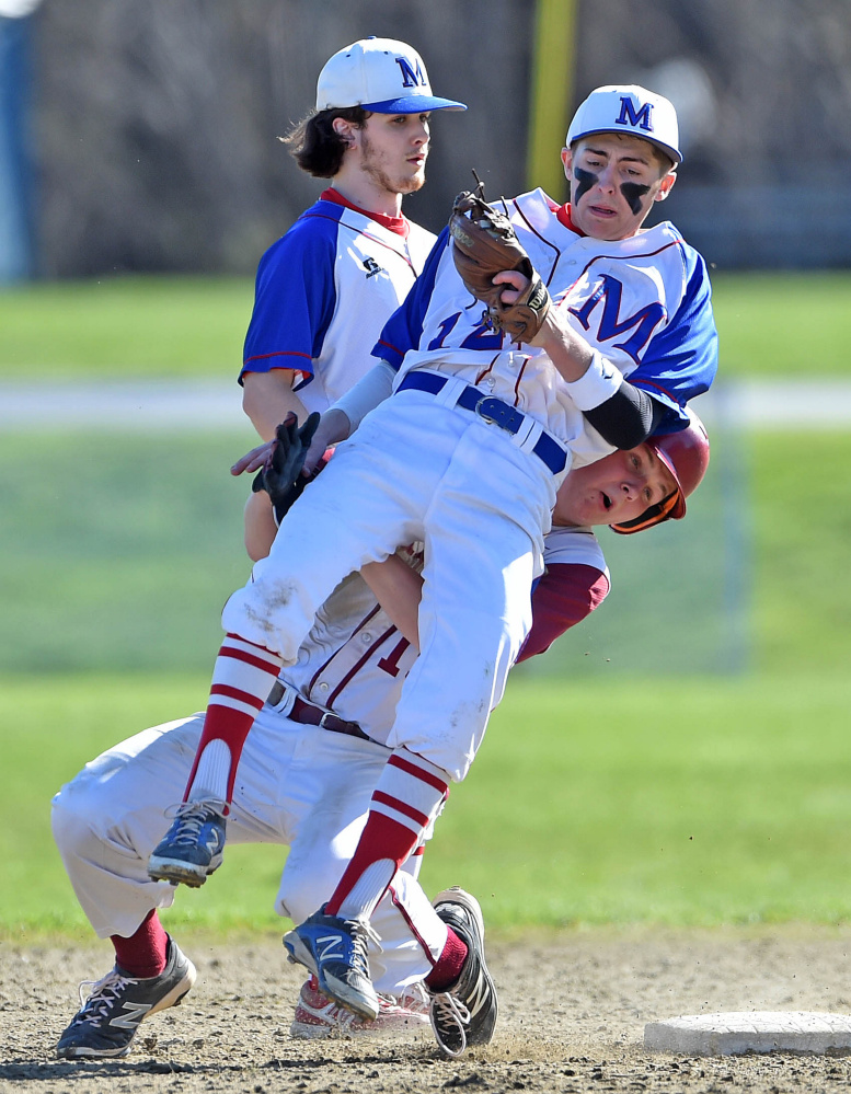 Staff photo by Michael G. Seamans   Bangor's Peter Kemble (19) collides with Messalonskee shortstop Jared Cunningham (12) after being forced out at second base Friday in Oakland.