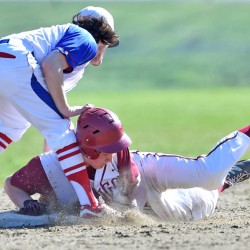 Bangor's Peter Kemble (19) slides safely into second base under the tag of Messalonskee second baseman Sam Bell (3) on Friday in Oakland.