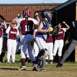 Members of the Richmond softball team jump for joy after Cassidy Harriman scored the winning run in the bottom of the seventh inning Friday in Richmond. Sacopee catcher Grace Sanborn stands at plate.