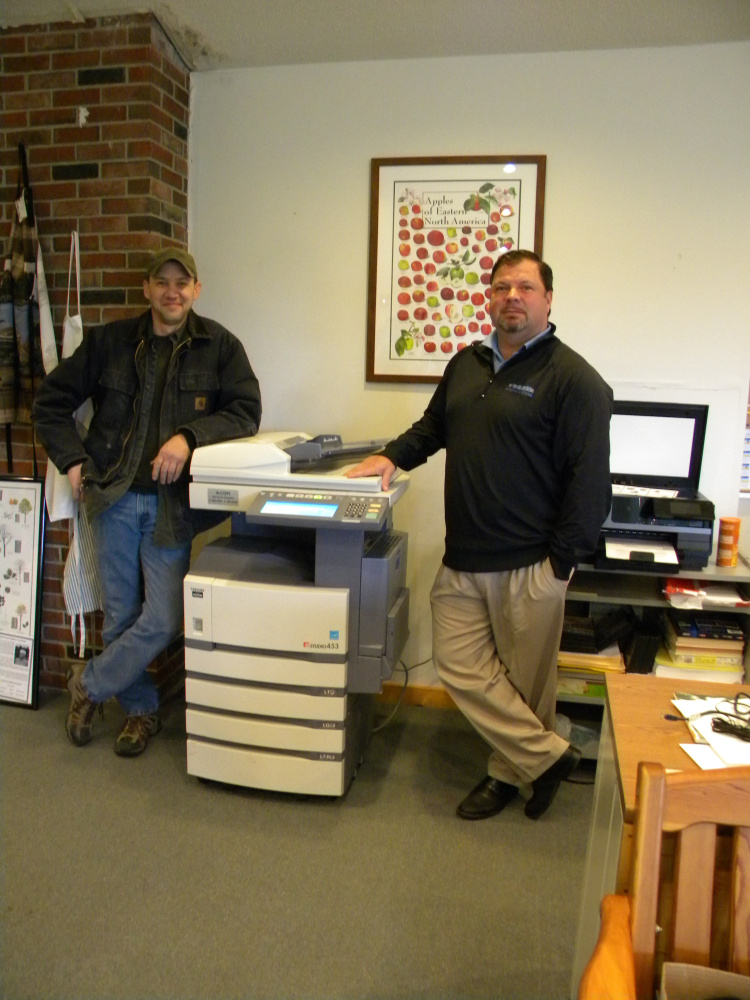 Rob Couture, left, and Dan Gallant of A-COPI Imaging Systems of Gardiner deliver and set up the Viles Arboretum's new copy machine, which the company donated.
