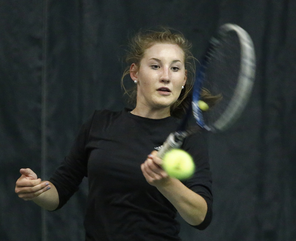 In this June 1, 2015 photo, Bethany Hammond, of St. Dominic Academy, returns a shot in the girls tennis singles state championship matches. Hammond, of Belgrade, won the mixed doubles division with Cole Ouellette, of Lewiston, at the Hall-Dale Invitational on Saturday at Hall-Dale High School.