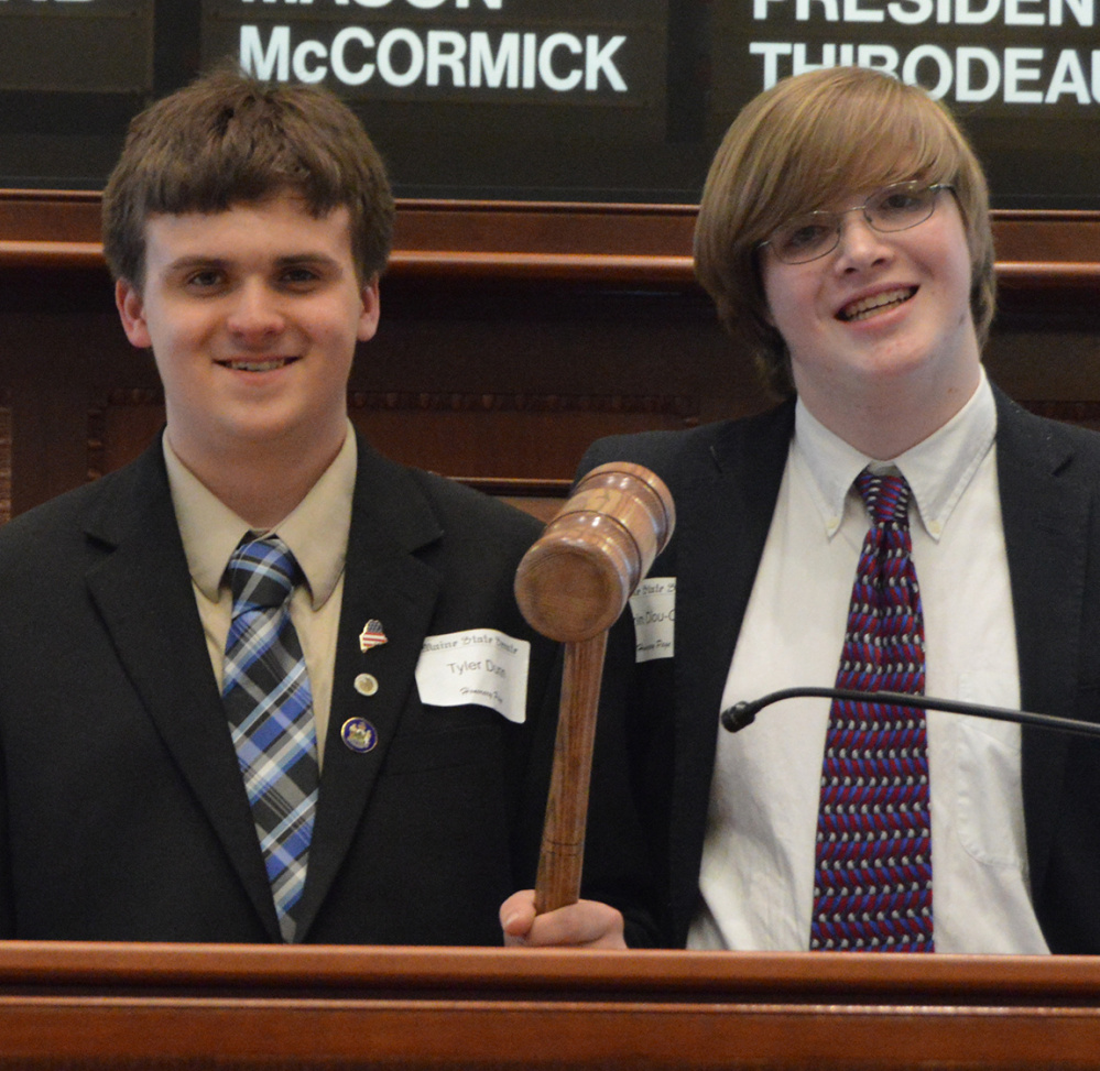 Maranacook Community High School students Tyler Dunn and Gavin Diou-Cass served as Honorary Pages for the day's legislative session on April 12 at the State House. From left are Dunn and Diou-Cass.