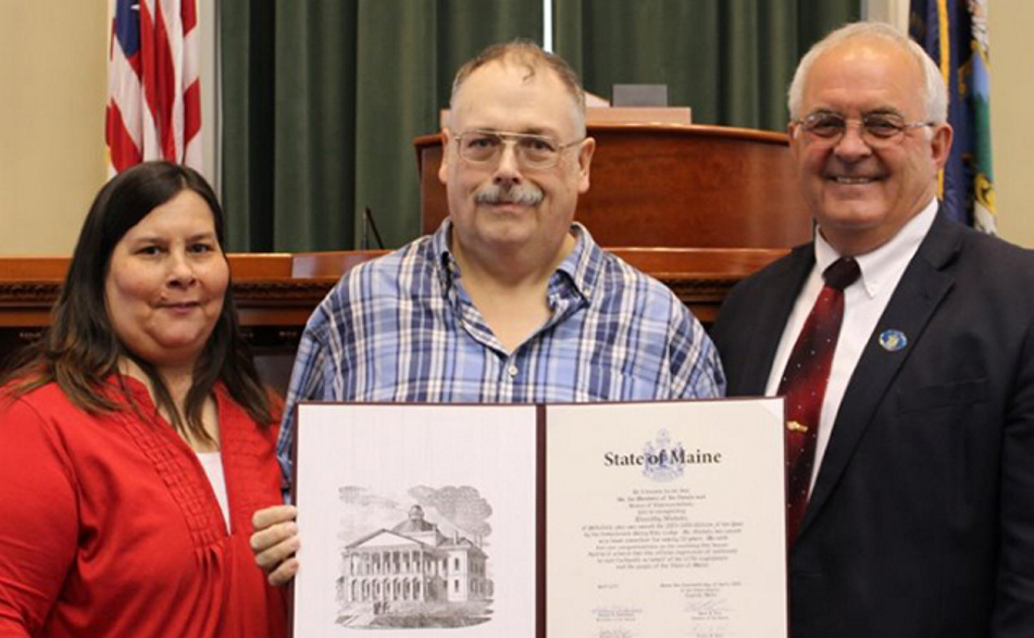 Rep. Stanley Short Jr., D-Pittsfield, recently honored Timothy Nichols of Pittsfield with a legislative sentiment at the State House in Augusta. From left are Dale Nichols, Tim Nichols and Rep. Stanley Short Jr.