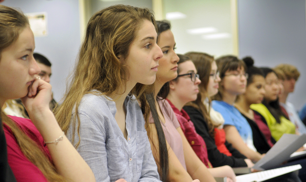 Gardiner Area High School students listen Monday to a panel discussion on women's rights at the school.