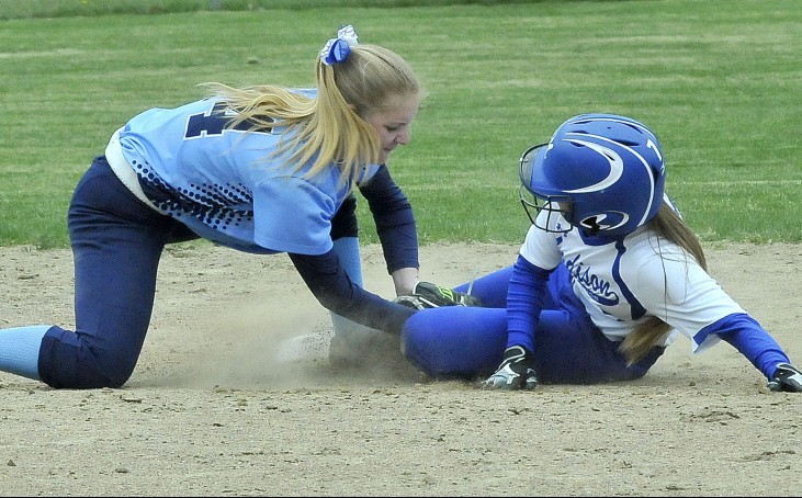 Madison runner Sydney LeBlanc slides safely into second base as Telstar's Lisa Gammon applies the tag during a Mountain Valley Conference game Monday in Madison. The Bulldogs won 3-1.