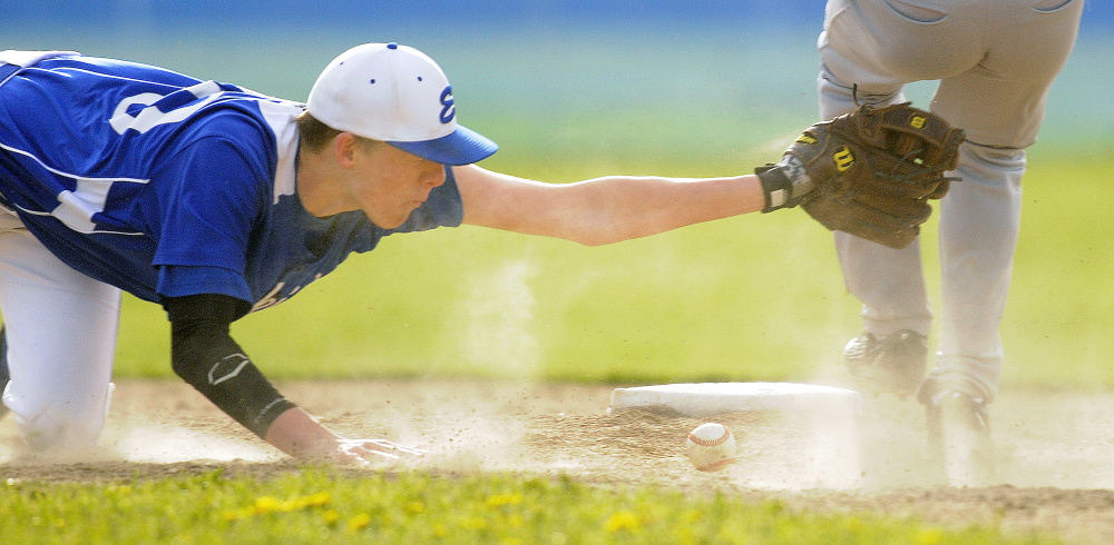 Erskine's Noah Bonsant can't make the tag on Gardiner's Isaiah Swan at second after the ball drops from his glove during a Kennebec Valley Athletic Conference Class B game Monday afternoon in South China.