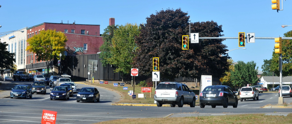 Traffic moves through the intersection of Spring, Water and Main streets in downtown Waterville in 2014. The intersection is one being studied as an overall downtown traffic study.