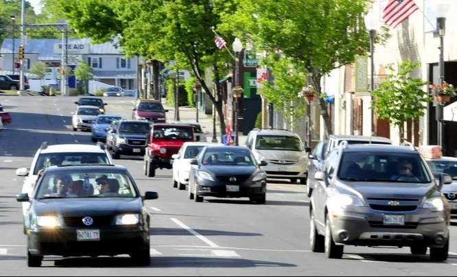 Traffic moves through downtown Waterville on the one-way Main Street. City officials are exploring ideas to return Main and Front streets to two-way traffic to ease congestion, slow traffic down and encourage shoppers to patronize downtown businesses.