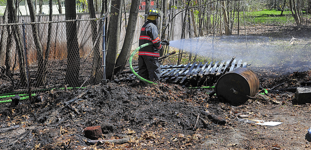 Gardiner firefighter Roy Girard was one of several area firefighters who responded on Tuesday to a report of a small brush fire on Pleasant Street in Gardiner.
