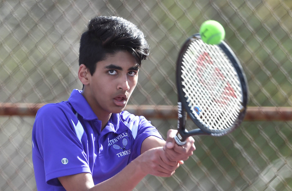 Waterville's Mohammad Ali Sheikh returns a serve from Belfast's Jordan Bickford during a tennis match Tuesday at the North Street courts in Waterville. Bickford won 6-2, 4-6, 6-2.