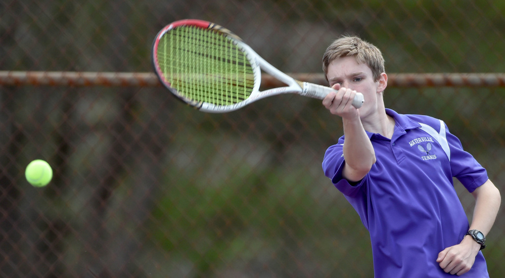 Bridger Holly returns a shot from Belfast's Wendall Gratton during a tennis match Tuesday at the North Street courts in Waterville. Bridger won 6-0, 6-2.