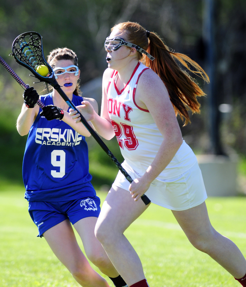 Staff photo by Joe Phelan Erskine's Renee Beaudoin, left, defends Cony's Lauren Coniff during a game Tuesday in Augusta.