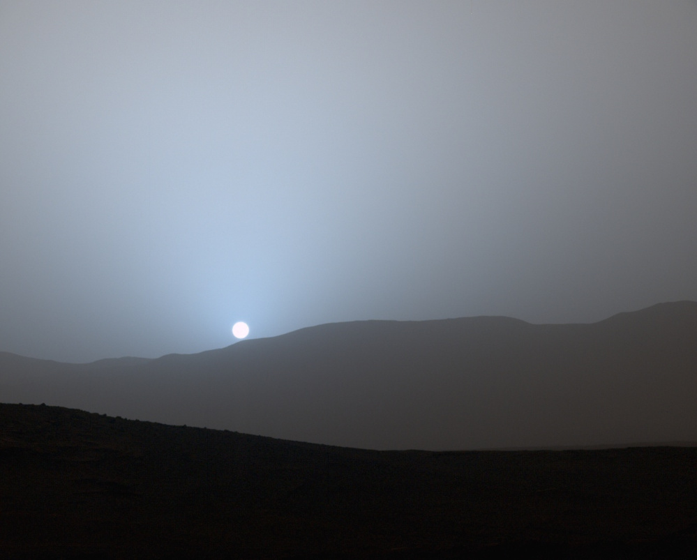 NASA's Curiosity Mars rover recorded this view of the sun setting at the close of the mission's 956th Martian day, or sol (Earth date April 15, 2015), from the rover's location in Gale Crater.