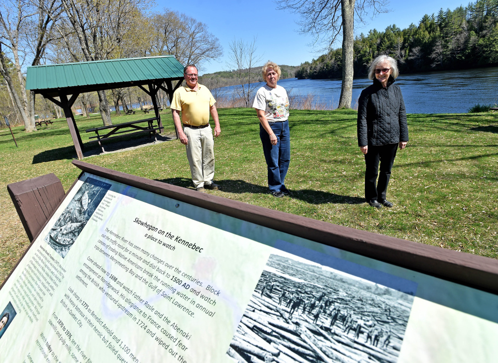 Gregory Dore, left, treasurer of the Somerset Woods Trustees, stands with Debra Burnham, center, and Jeanne Shay, right, both with the Bloomfield Garden Club, on Wednesday at the Great Eddy of the Kennebec River on U.S. Route 2 in Skowhegan. The garden club wants to replace the Blue Star Memorial Highway marker that was swept away in the 1987 flood.