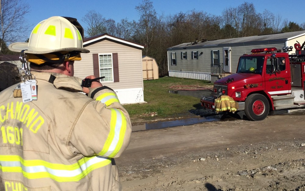 Richmond Fire Chief Matt Roberge oversees a cleanup effort after a fire damaged a Richmond mobile home Wednesday afternoon.