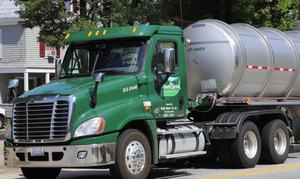 A Poland Spring tanker truck rolls through Fryeburg. The Maine Supreme Judicial Court has affirmed regulators' approval of a contract allowing the Fryeburg Water Co. to sell water to Nestle Waters, which owns Poland Spring.
