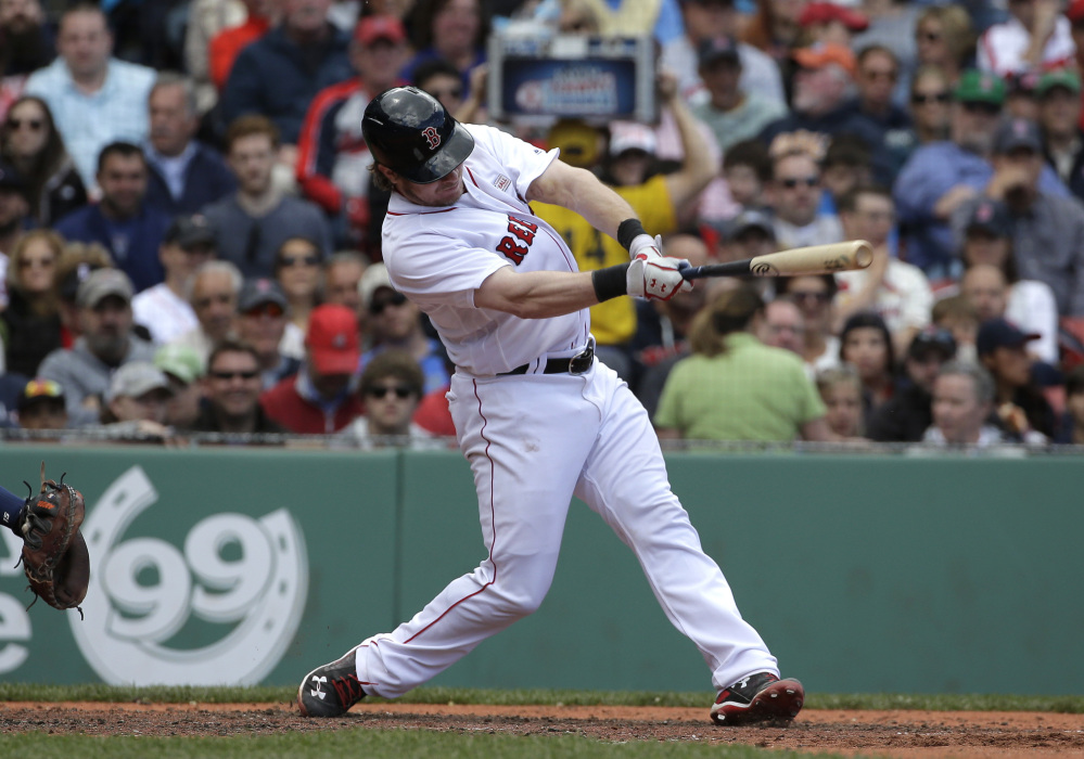 Boston's Ryan Hanigan hits an RBI single in the third inning against the Houston Astros on Sunday at Fenway Park in Boston.