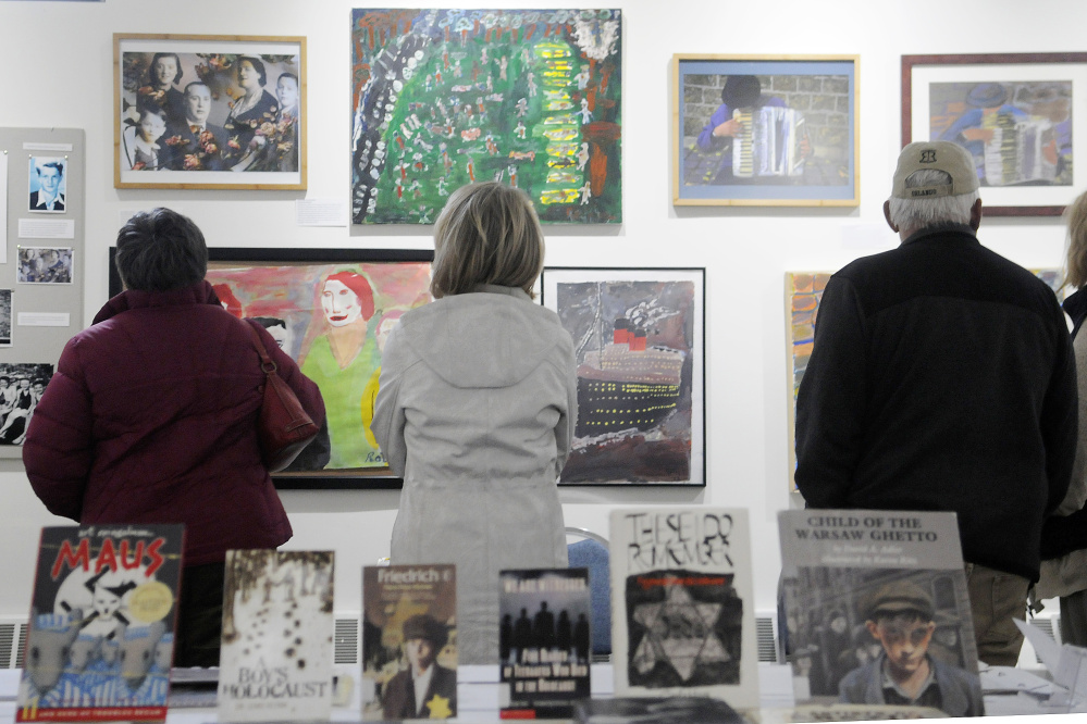 "Pieces of art and books on display Monday at the exhibit ""Those People … Well, They're Not People at All: Children's Reactions to the Holocaust"" displayed in the Holocaust and Human Rights Center of Maine in Augusta."