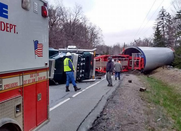 A loaded truck hauling a wind turbine base from the Quebec border to a wind energy project in Bingham rolled over Monday when the driver lost control on a corner in Johnson Mountain Township.