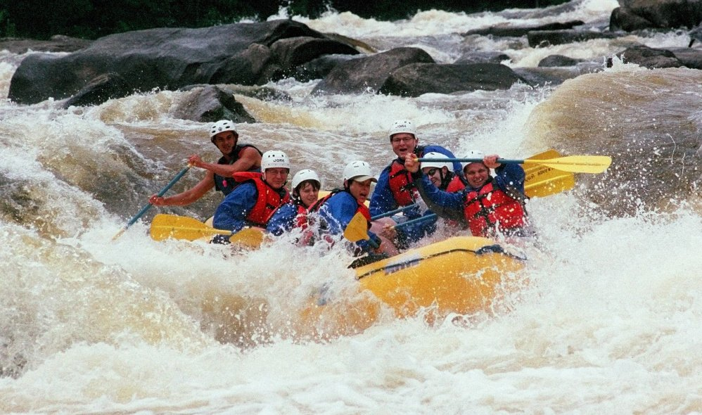 Whitewater rafters on a North Country Rivers outing paddle through the Cribworks rapids on the Penobscot River several years ago. A Massachusetts man died Saturday while on a North Country Rivers trip on the Dead River through West Forks Plantation. The Maine Warden Service said that the trip was operating in accordance with state law.